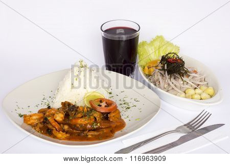 PERUVIAN FOOD: Lunch Cebiche and Picante de Mariscos with rice and a glass of chicha morada.