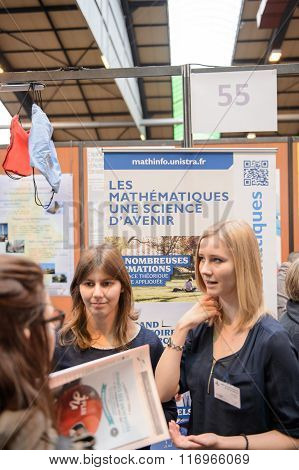 STRASBOURG FRANCE - FEB 4 2016: Children and teens of all ages attending annual Education Fair to choose career path and receive vocational counseling - Superior Mathematics faculty stand
