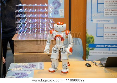 STRASBOURG FRANCE - FEB 4 2016: Children and teens of all ages attending annual Education Fair to choose career path and receive vocational counseling - Robot at engineering studies stand