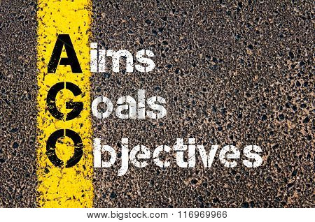 Concept image of Business Acronym AGO Aims Goals Objectives written over road marking yellow paint line. poster