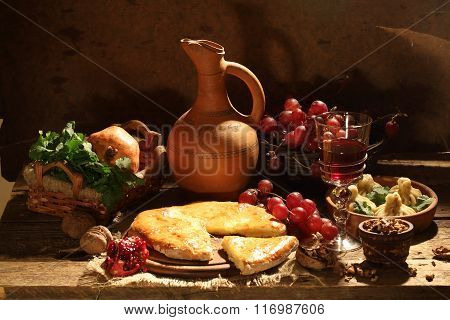 Piece Of A Cheese Pie, Fruit And Red Wine In A Glass