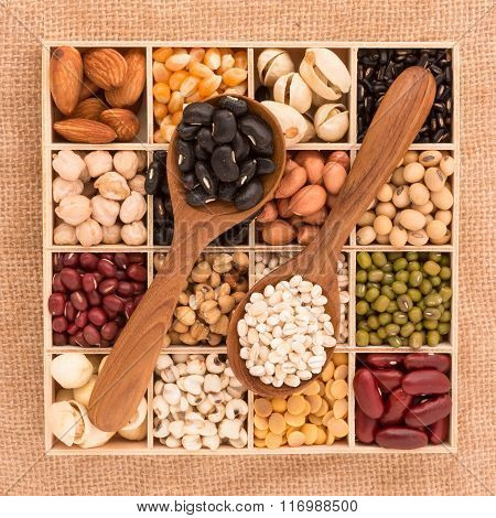 Assortment Of Beans And Lentils In Wooden Spoon With Wood Box Macadamia Isolated On White . Mung Bea