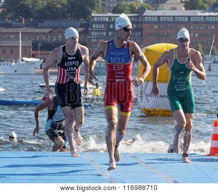 Mario Mola And Other Swimmers Climbing Up From The Water
