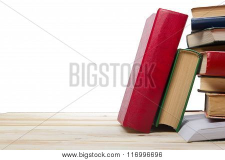 Stack of books at wooden shelf isolated on white background. Back to school. Copy space for text