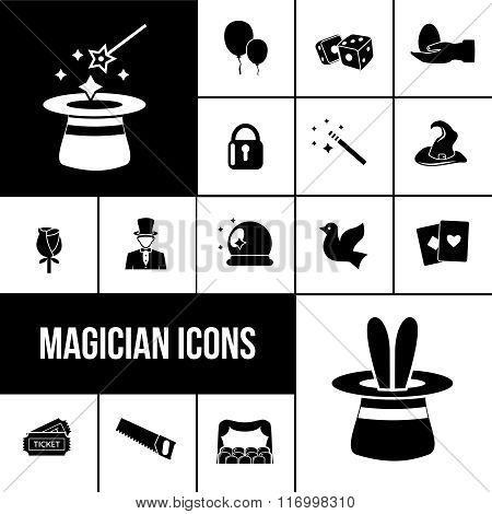 Magician icons black set with rabbit in hat, magic wand and playing cards isolated vector illustration
