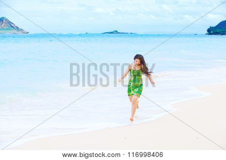 Beautiful Teen Girl In Green Dress Running Along Hawaiian Beach