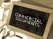 Commercial Documents Handwritten by White Chalk on a Blackboard. Composition with Small Chalkboard on Background of Working Table with Office Folders, Stationery, Reports. Blurred Background. Toned Image. poster