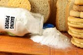 baking powder in a glass jar  with cookie and bread for baking related poster
