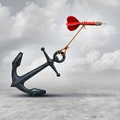 Challenges in business as a dart being slowed down by a heavy anchor as an adversity metaphor and symbol or overcoming a handicap to achieve your goal to reach the target. poster