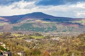 View across the Heads of the Valleys Road near Abergavenny towards the Sugar Loaf or Mynydd Pen-y-Fal a hill or mountain in Monmouthshire Wales United Kingdom. poster