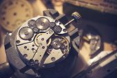 Old Watchmaker Studio. A watch makers work top. The inside workings of a vintage mechanical watch. poster