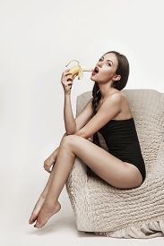 Sexy Woman Eating Fruits