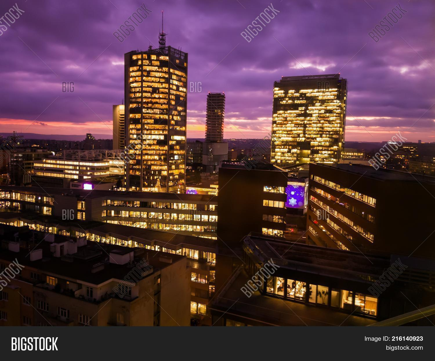 Prague Skyscrapers In Blue Hour With Purple Sky. Modern Building  Architecture After Sunset. Office
