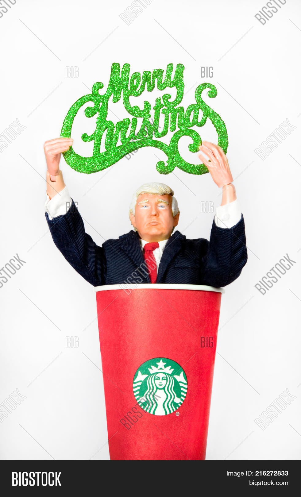 donald trump caricature action figure holding a merry christmas sign while coming out of a starbucks - Starbucks Merry Christmas