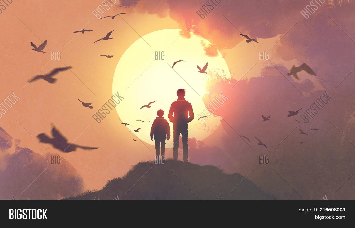 Silhouette of father and son standing on the mountain looking at the sun rising in the