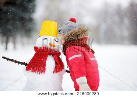 Little Boy Tell Snowman About His Secrets Or Gifts For Christmas