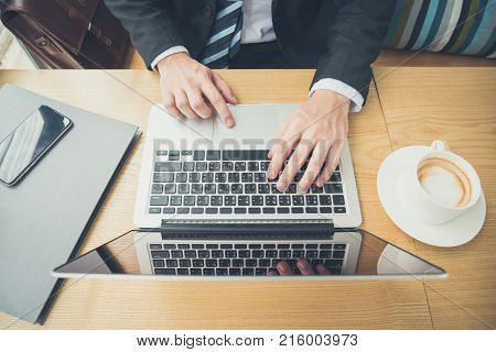 Top view og businessman hands typing on laptop computer keyboard