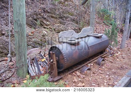Rusty old mine toilet  sitting on track