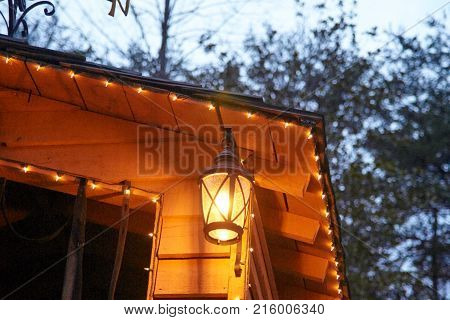 Old light hanging under building roof outside