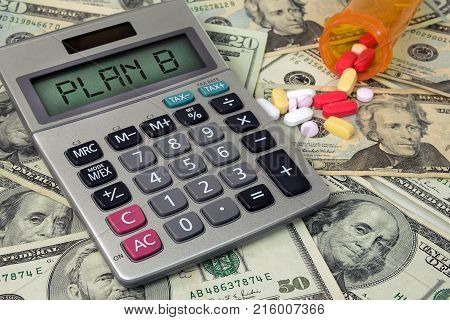medicare Plan B text sign on calculator screen with prescriptions drugs and bottle on paper money