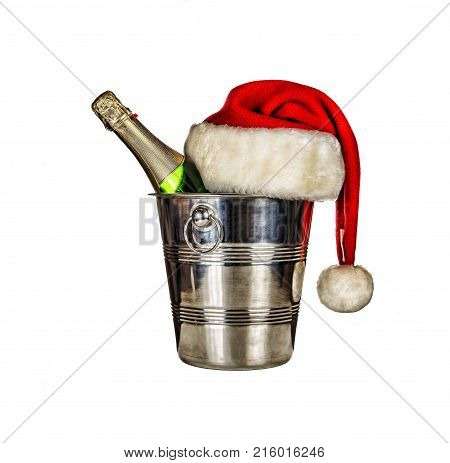 A Bottle Of Champagne In An Ice Bucket And A Santa Claus Hat Isolated On White Background