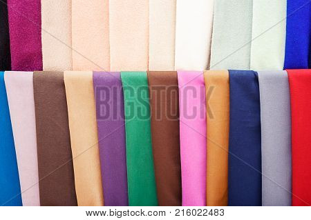 Colorful strips of fabric hang in the store. colored bright Strips of fabric hang in the store. Sale of textiles