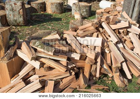 Natural wooden background closeup of chopped firewood. Chopped firewood on a stack. Pile of firewood