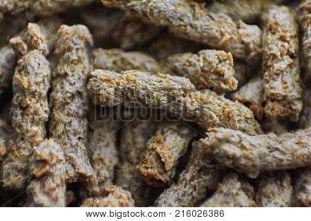 Bran (miller's bran) macro background. Background from heap of extruded rye bran. Macro. Selective focus. Healthy food for a healthy diet
