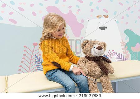 Girl Doing Neurology Examination Of Teddy Bear