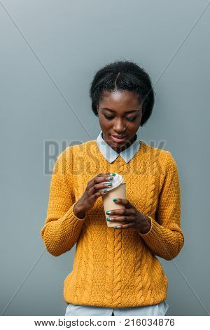 young african american woman with disposable cup of coffee