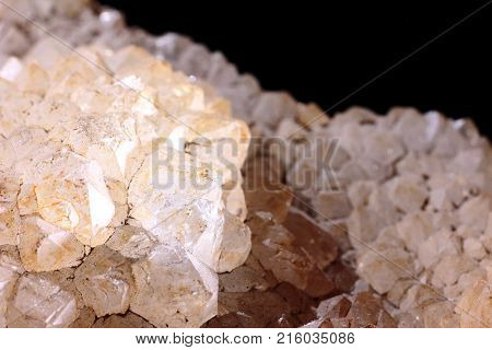 Closeup photograph of quartz stone on a black background. Natural phenomenon.