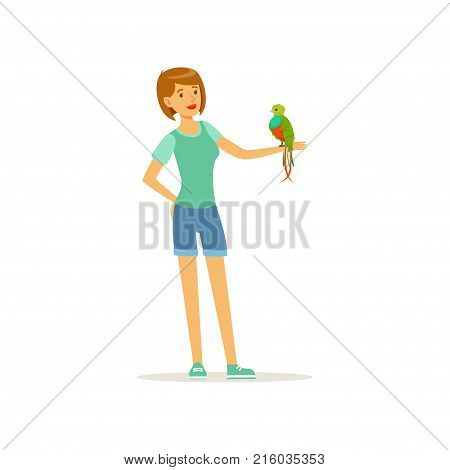 Woman holding tropical bird with colored feathers on her hand. Smiling female character and macaw parrot. Pet and friendship concept. Domestic animal. Flat design vector illustration isolated on white