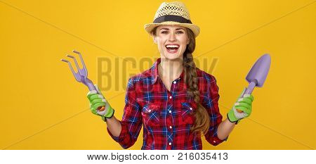 Smiling Modern Woman Farmer Showing Gardening Tools