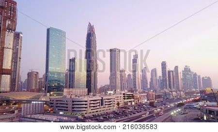Beautiful aerial view with sky from top to sunrise and city futuristic skylines buildings and infrastructure. Dubai, United Arab Emirates. Top view of Dubai at sunrise.