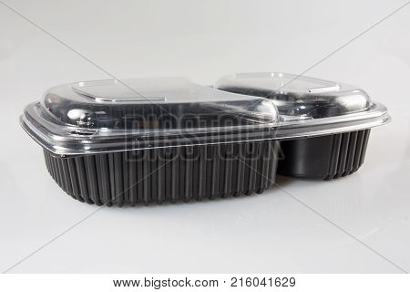 Plastic Package With A Black Lid And A Clear Lid For Food