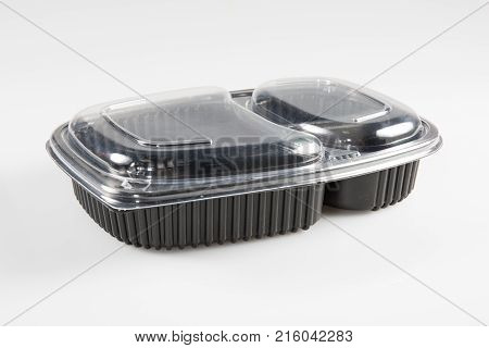Industrial Food Packaging With Two Compartments On A White Background
