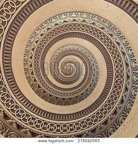 Bronze copper geometrical abstract ornament spiral fractal pattern background. Metal spiral pattern effect background. Concept abstract spiral symmetrical pattern. Abstract spinning effect background