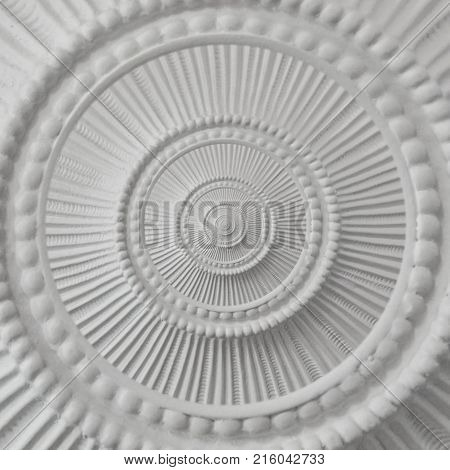 Gypsum stucco moulding plasterwork round abstract fractal pattern background. Plaster abstract inside out effect background White gypsum abstract background Decorative stucco element concept fractal
