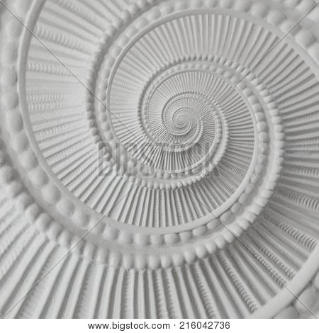 White stucco moulding plasterwork spiral abstract fractal pattern background. Plaster abstract spiral effect background White spiral abstract background Decorative stucco element concept fractal swirl