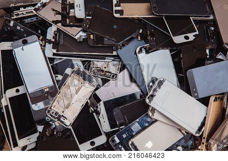 TOMSK RUSSIA - November 29 2017: broken panels and screens of iPhone phones lie in the service and are preparing for recycling and disposal