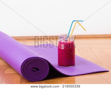 Smoothie And Yoga Mat On Floor