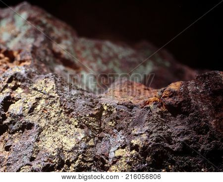 Colorful copper ore closeup photograph on a black background, natural phenomenon.