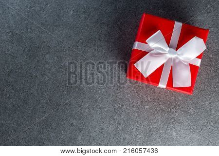 Gift trends. Thinking about new year, Christmas and valentine day gifts and online shopping. Red box present with bow.