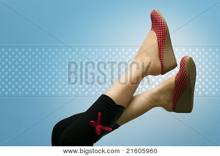 Lady's Attractive Feet With Polka Dotted Shoes