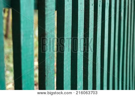 Bright green wood wooden fence gate close up shot