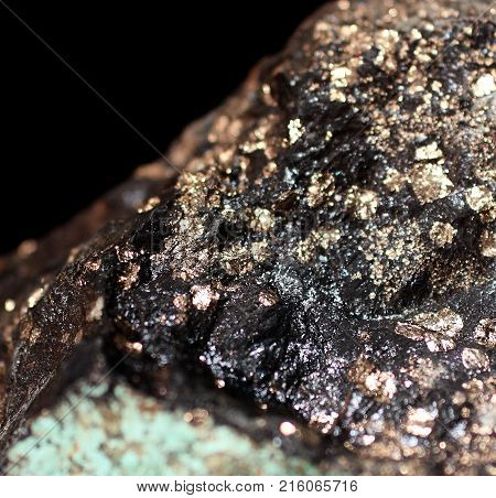 Pyrites and azurite natural phenomenon glittering on a black background. Abstract look.