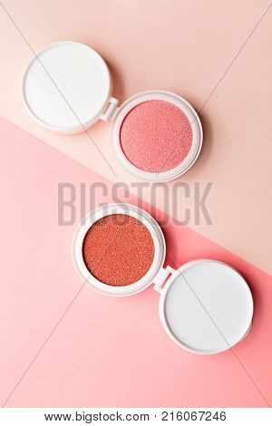 Two blushes for make-up in the form of cushion on dowble background