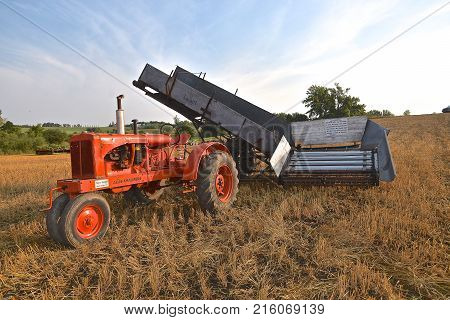 ROLLAG, MINNESOTA, Sept 2, 2017:  An Allis Chalmers tractor pulling a shock loader is displayed at the annual WCSTR farm show in Rollag held each Labor Day weekend where 1000's attend