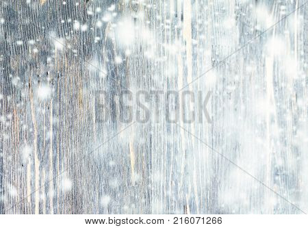 Christmas Background with falling snow. Abstract Snow Background with wooden texture
