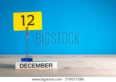 December 12th mockup. Day 12 of december month, calendar on blue background. Winter time. Empty space for text.